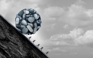 Opioid crisis and prescription painkiller addiction epidemic concept as a group of people running away from dangerous pills as a medical addict problem with 3D illustration elements.