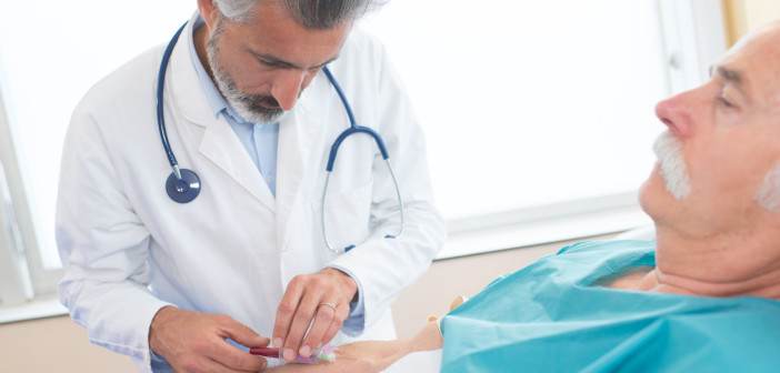 78800628 - doctor taking blood from patient's arm