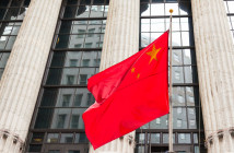 38171467 - chinese flag floating in front of a goverment building
